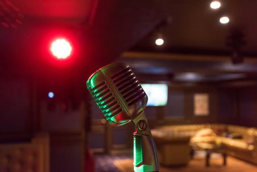 Retro music microphone on stage in a night club. Show or performance concept
