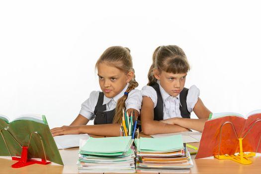 Two quarreling girls at the same desk
