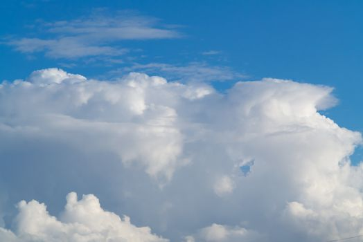 beautiful white cumulus clouds in the blue sky during the day