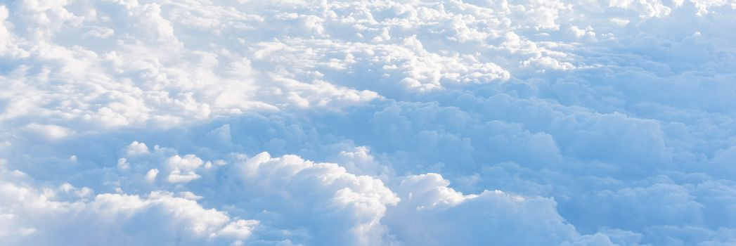 Panoramic unreal and dramatic Altocumulus cloud formation at sunrise from airplane