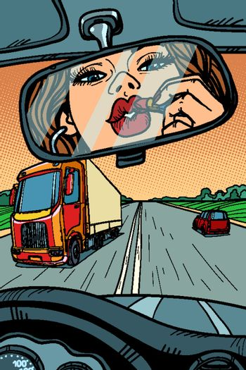 driver woman paints lips with lipstick. attention on the road