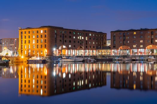 Sunset dusk at UNESCO world heritage site the Royal Albert Dock Liverpool at Pier head in Liverpool England UK.