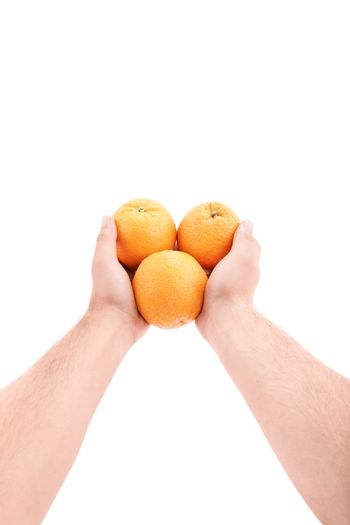 Would you like some oranges? Male hands giving oranges, isolated on white background.