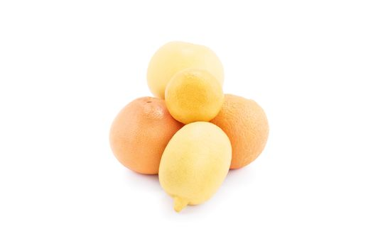 A pile of yellow and orange fruits, isolated on white background. Lemon, orange, citrus and tangerine isolated on white background.