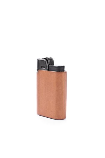 Close up shot of a lighter in brown leather cover, isolated on white background.