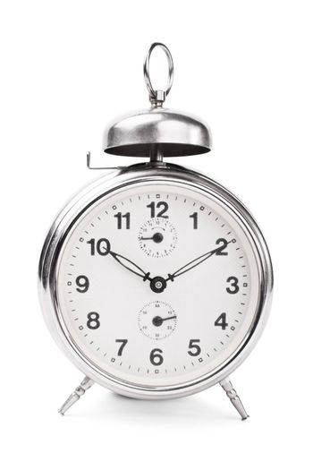 Old fashioned alarm clock isolated on white background.