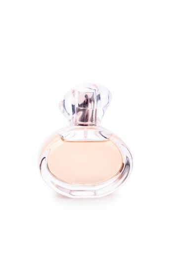 Close up shot of a transparent perfume bottle, isolated on white background.