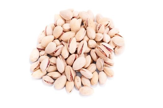 Top perspective of a heap of pistachios, isolated on white background.