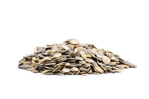 Heap of pumpkin seeds isolated on white background.