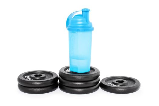 Protein shaker on a pedestal of weight plates, isolated on a white background. Look after your health and well being.