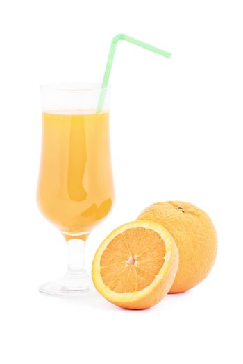 Ripe orange with glass of orange juice, isolated on white background.