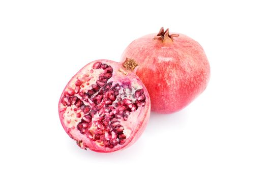 Ripe pomegranates isolated on white background.