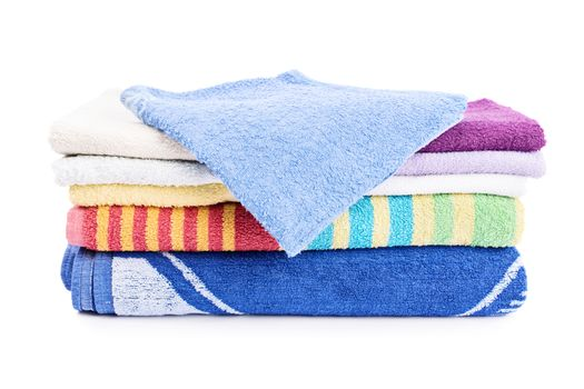 A stack of colorful folded bathroom towels, isolated on white background.
