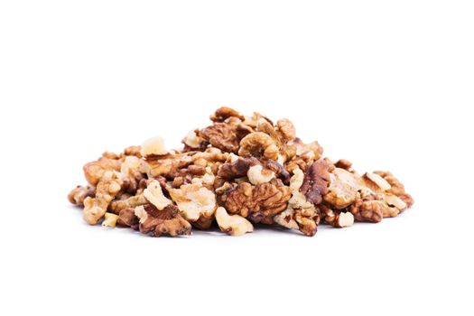 Close up shot of a heap of walnuts, isolated on white background.
