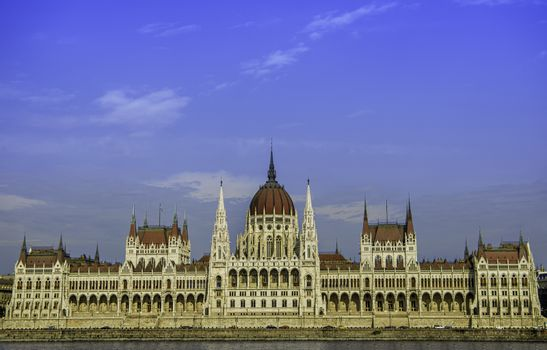 Front view of the Hungarian Parliament building from the Danube side during the day.
