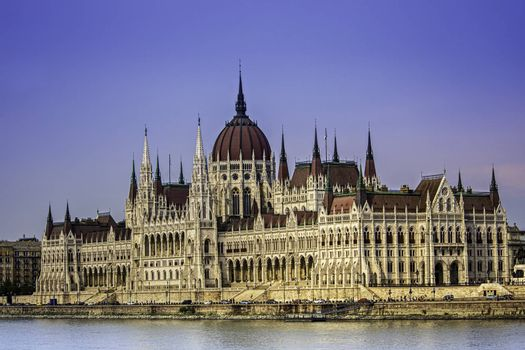 Close up shot of the Hungarian Parliament building from the Danube side, on a clear summer day.