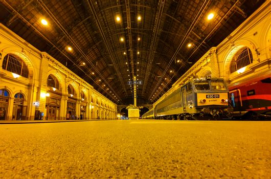 Ground view of the platforms at Keleti railway station in Budapest at night. Old trains at Keleti railway station in Budapest at night.