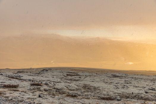 Snowy Winter Mountain range with sun light in Reykjavik Iceland