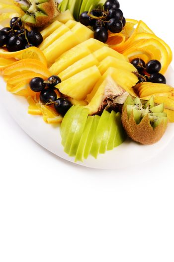 Slicing fruit with pineapple and grapes
