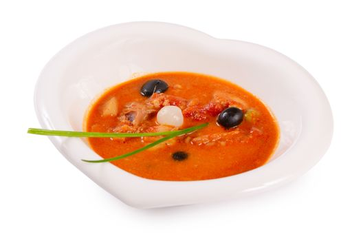 Solyanka soup with olives and onions close up