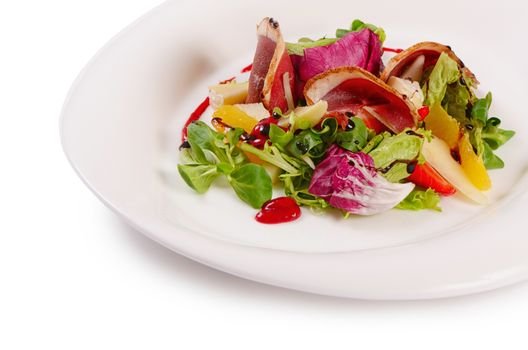 The salad with smoked duck breast close up