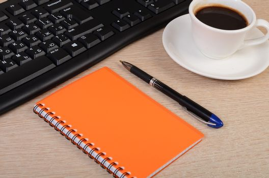 Keyboard with a Cup of coffee and notebook