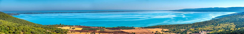 Lago di Varano panoramic view of Varano Lake in Gargano - Puglia - Italy- stitch shots high resolution panorama image .