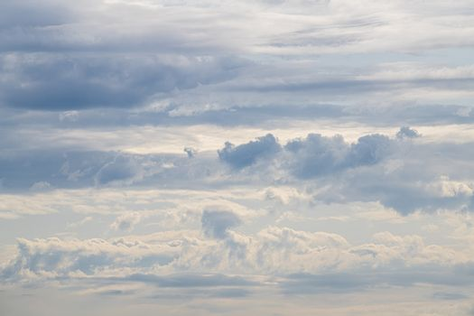 Cloudy skies in beautiful blue pastels in the summer in Netherlands