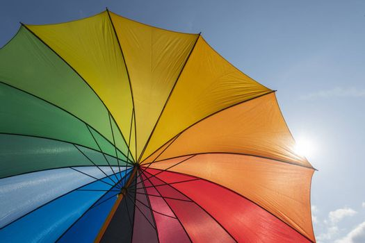 Colorful parasol in summer with backlight