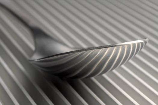 Abstract artistic picture of a spoon on a parallel grid structure