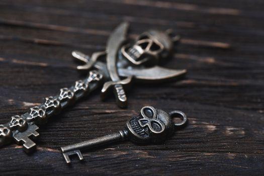Vintage skull skeleton keys on a wooden table. Close-up view