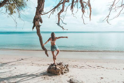 Girl at idyllic beach in early morning, balance, fitness, freedo