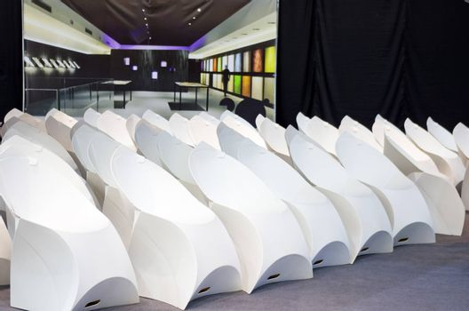 white modern chairs standing in a conference hall