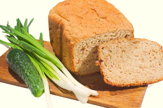 Freshly baked bread and vegetables on a white background