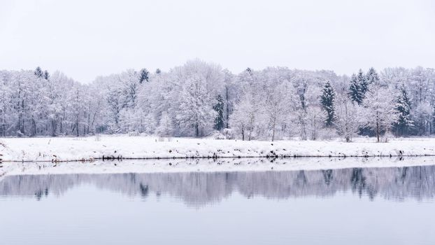 White winter landscape forest and fields countryside lake