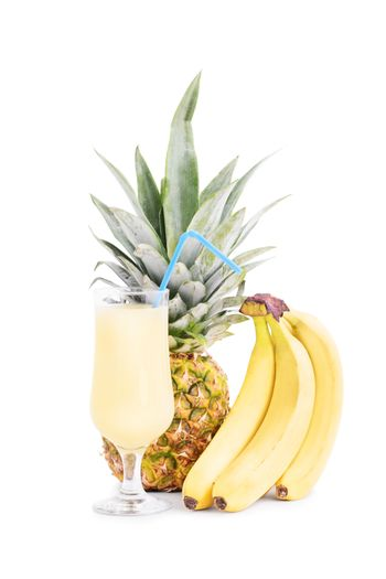 Bananas, pineapple and a smoothie glass, isolated on white background.