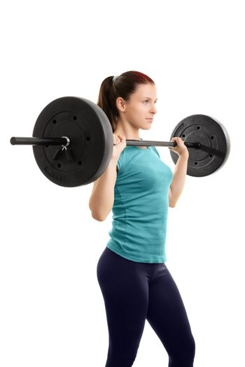 A portrait of a beautiful fit girl working out with a barbell, isolated on a white background.