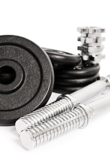 Close up shot of disassembled dumbbell, isolated on a white background.