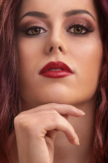 Close up portrait of a beautiful female model with make up, red lipstick and clean skin.