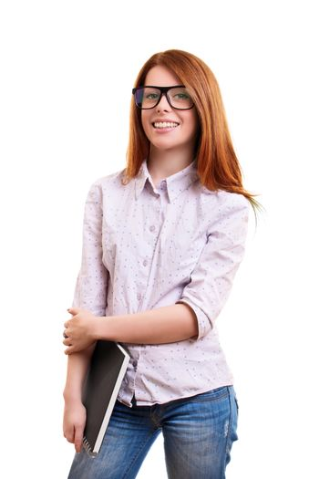 A portrait of a smiling cute nerd girl with glasses, holding a notebook, isolated on white background. I can't wait to go back to school.