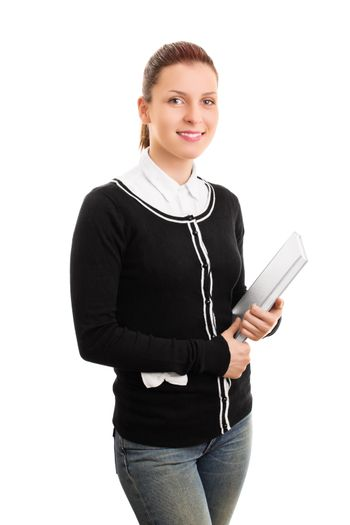Portrait of a female student in uniform holding some books, isolated on white background.