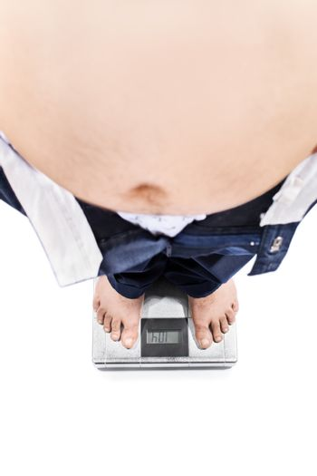 Top view of a young male with big stomach and weight problems standing on a scale, isolated on white background.