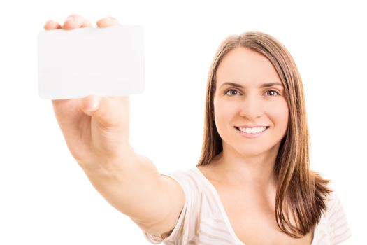 Beautiful young girl holding and presenting a blank information card, isolated on white background.