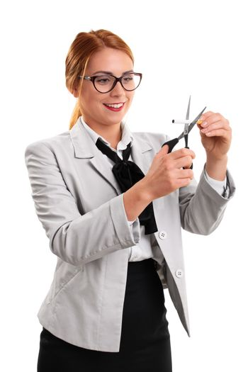 Young modern business woman cutting a cigarette with scissors, isolated on a white background.