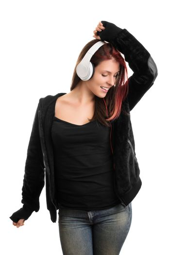 I'm dancing to my favorite song, mhm. Casually dressed young girl with headphones, dancing and listening to music, isolated on white background.