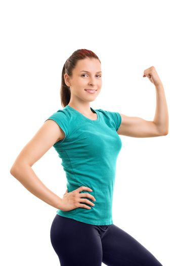 Staying fit. You need to work for it. Beautiful young girl flexing her arm and giving encouragement to go to the gym, isolated on white background.