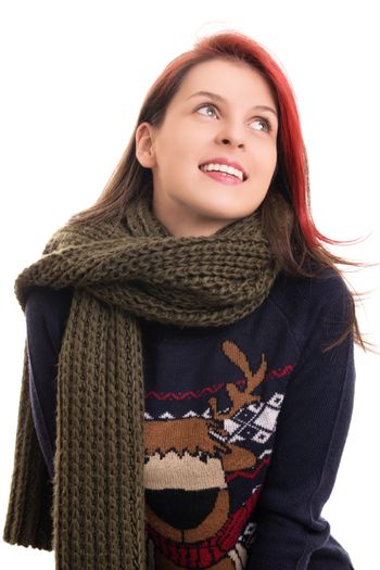 Portrait of a beautiful happy young girl in Christmas sweater and a knitted scarf, isolated on white background.