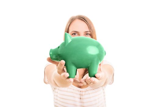 Young girl holding a piggy bank, isolated on white background.