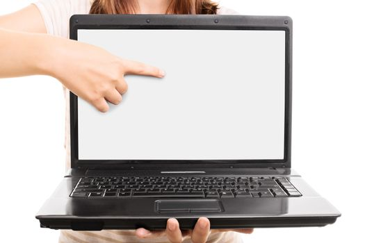 Close up shot of a young girl pointing at a blank laptop screen, isolated on white background.
