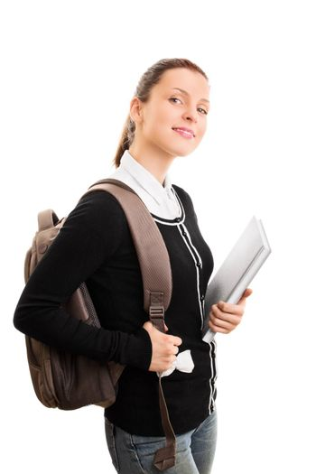 First day at school, college, uni. Young girl with books and backpack smiling, isolated on white background. Back to school, finally!